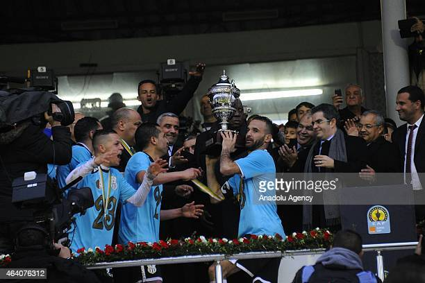 Players of Es Setif pose with the trophy after their winning at the African Super Cup match between CAF Champions League winner Algeria's ES Setif...