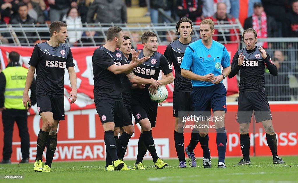 Players of Essen complain to referee Soeren Storks during the Regionalliga West match between KFC Uerdingen and Rot-Weiss Essen on November 9, 2014 in Krefeld, Germany.