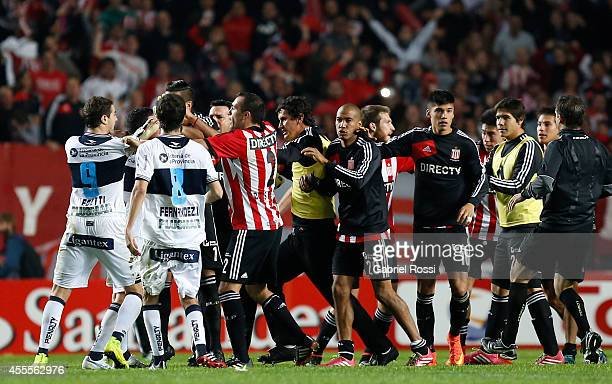 Players of Estudiantes and Gimnasia y Esgrima La Plata fight after a second leg match between Estudiantes and Gimnasia y Esgrima La Plata as part of...