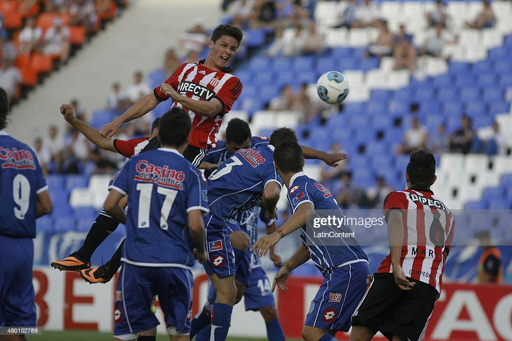 Players of Estudiantes and Godoy Cruz try to head the ball during a match between Godoy Cruz and Estudiantes as part of Torneo Inicial at Mundialista Stadium on November 16, 2013 in Mendoza, Argentina.