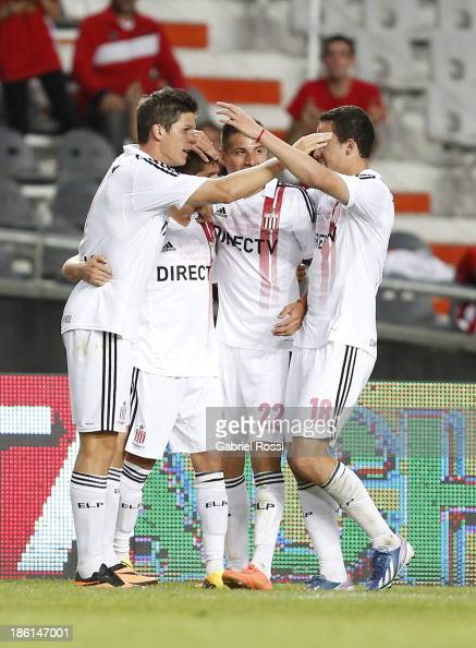 Players of Estudiantes celebrate a goal during a match between Estudiantes and Quilmes as part of the 13th round of the Torneo Inicial 2013 at Ciudad...