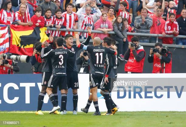 Players of Estudiantes de la Plata celebrate a goal against Atlético Madrid during a match between Estudiantes de La Plata and Atletico de Madrid as...
