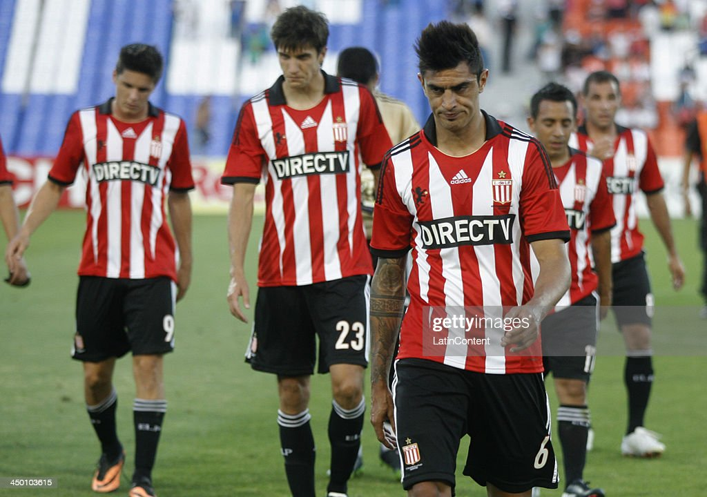 Players of Estudiantes leave the field after a match between Godoy Cruz and Estudiantes as part of Torneo Inicial at Mundialista Stadium on November 16, 2013 in Mendoza, Argentina.