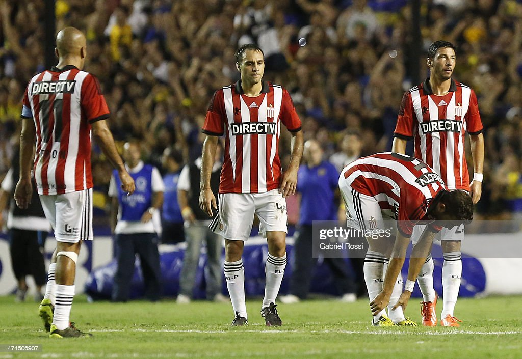 Players of Estudiantes looks dejected after finish the match between Boca Juniors and Estudiantes as part of forth round of Torneo Final 2014 at Estadio Unico de La Plata on February 23, 2014 in La Boca, Buenos Aires, Argentina.
