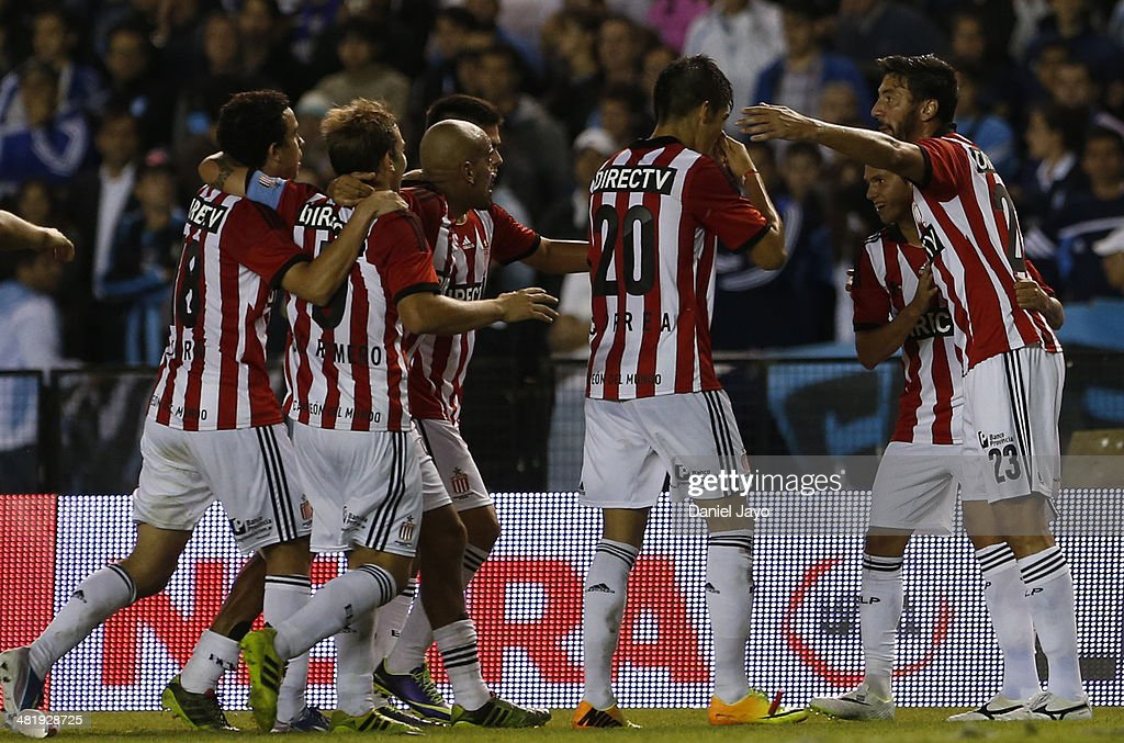 Players of Estudiantes the third goal of his team scored by Patricio Rodriguez during a match between Racing Club and Estudiantes as part of 11th round of Torneo Final 2014 at Presidente Peron Stadium on April 1, 2014 in Buenos Aires, Argentina.