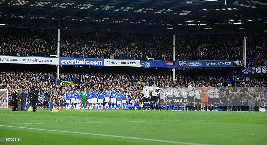 Players of Everton and Tottenham Hotspur line up for a minutes silence in respect of Rememberance Sunday during the Barclays Premier League match between Everton and Tottenham Hotspur at Goodison Park on November 3, 2013 in Liverpool, England.