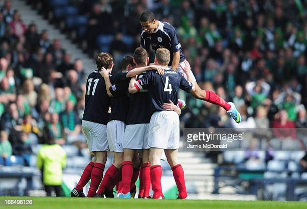 PLayers of Falkirk celebrate there first goal during The William Hill Scottish Cup Semi Final between Falkirk and Hibernian at Hampden Park on April...