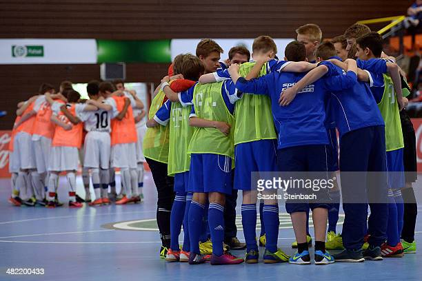 Players of FC Astoria Walldorf and Buedelsdorfer TSV line up during the DFB B And C Juniors Indoor Cup on March 30 2014 in Gevelsberg Germany