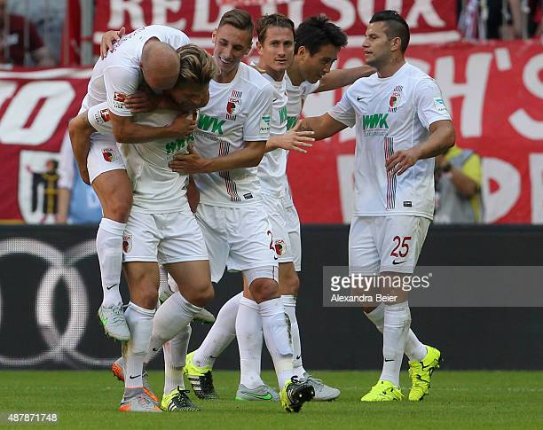 Players of FC Augsburg celebrate Alexander Esswein's goal during the Bundesliga match between FC Bayern Muenchen and FC Augsburg at Allianz Arena on...
