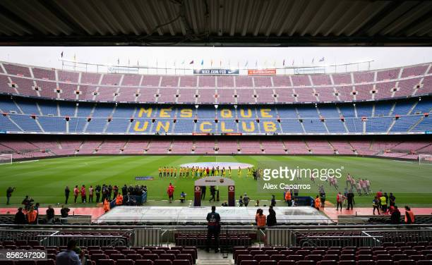 Players of FC Barcelona and UD Las Palmas enter the pitch for their La Liga match at Camp Nou on October 1 2017 in Barcelona Spain The match is...