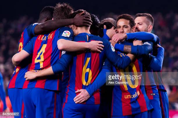 Players of FC Barcelona celebrate after their teammate Lionel Messi scored their second team's goal with a penalty shot during the La Liga match...