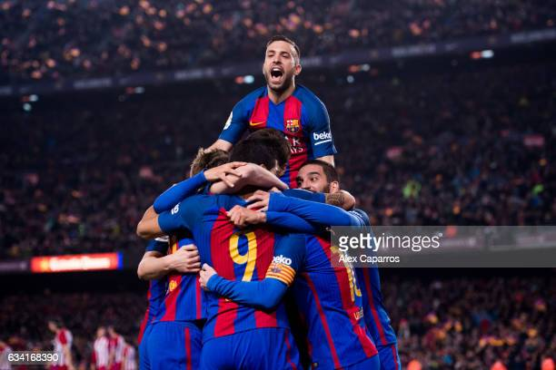 Players of FC Barcelona celebrate after their teammate Luis Suarez scored the opening goal during the Copa del Rey semifinal second leg match between...