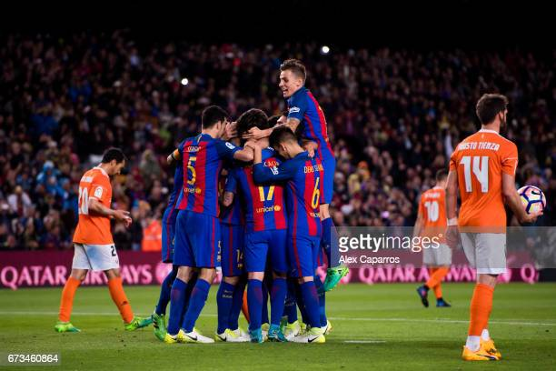 Players of FC Barcelona celebrate with their teammate Javier Mascherano after he scored their team's sixth goal during the La Liga match between FC...