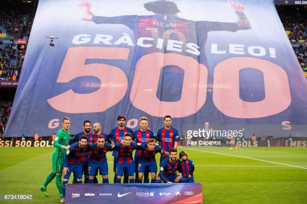Players of FC Barcelona pose as the Camp Nou stadium pays tribute to Lionel Messi for scoring his 500th goal with the team before the La Liga match...