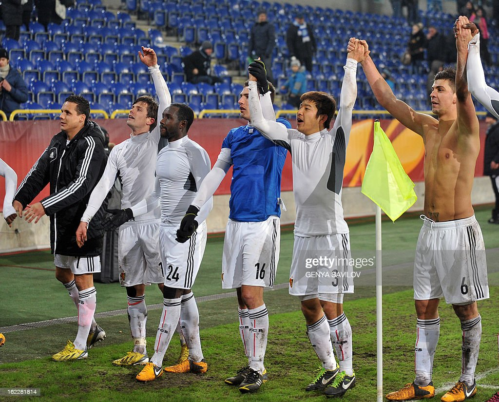 Players of FC Basel celebrate after their UEFA Europa League, Round 32, football match against FC Dnipro in Dnipropetrovsk on February 21, 2013. AFP PHOTO/ GENYA SAVILOV
