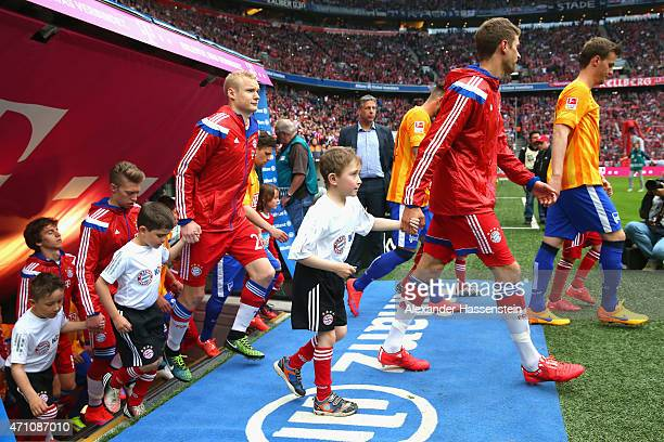 Players of FC Bayern and Berlin walk in with organ donation children for the Bundesliga match between FC Bayern Muenchen and Hertha BSC Berlin at...