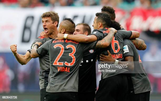 Players of FC Bayern Muenchen celebrate after winning the Bundesliga match between RB Leipzig and Bayern Muenchen at Red Bull Arena on May 13 2017 in...