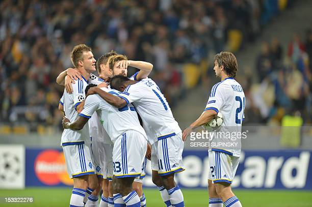 Players of FC Dynamo Kiev react after they scored against GNK Dinamo Zagreb during during UEFA Champions League Group A football match in Kiev on...