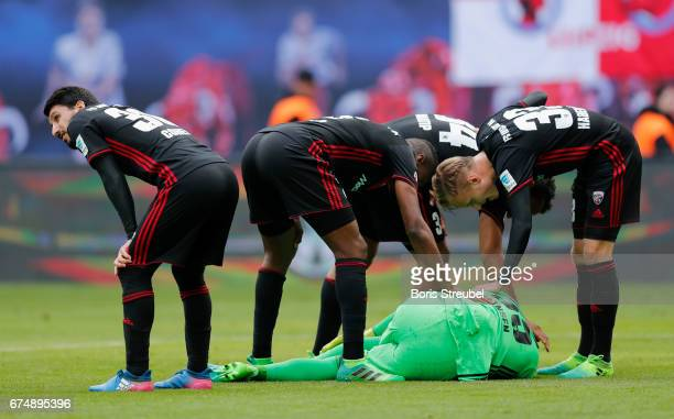 Players of FC Ingolstadt 04 care about their goalkeeper Martin Hansen of FC Ingolstadt 04 during the Bundesliga match between RB Leipzig and FC...