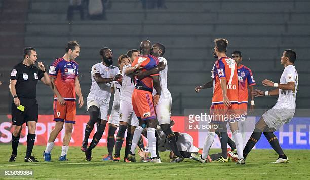 Players of FC Pune City and Northeast United FC have an argument during the Indian Super League football match between North East United FC and FC...