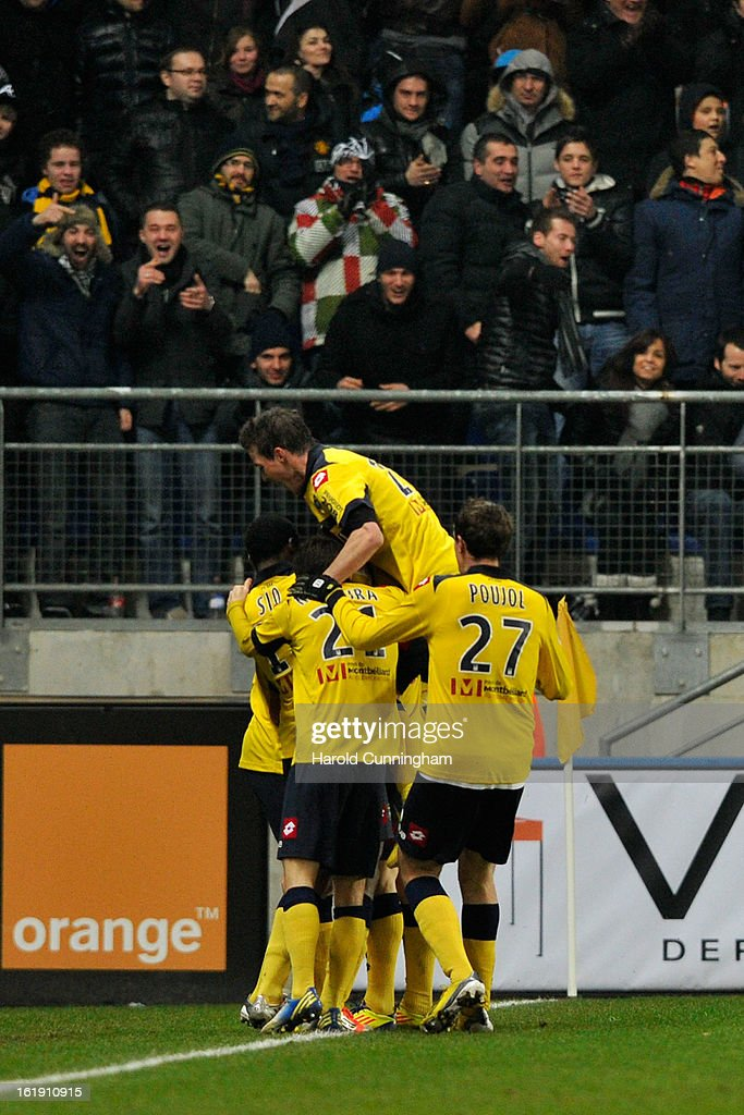 Players of FC Sochaux-Montbeliard celebrate after Sébastien Roudet scored their first during the French League 1 football match between FC Sochaux-Montbeliard and Paris Saint-Germain FC at Stade Auguste Bonal on February 17, 2013 in Montbeliard, France.