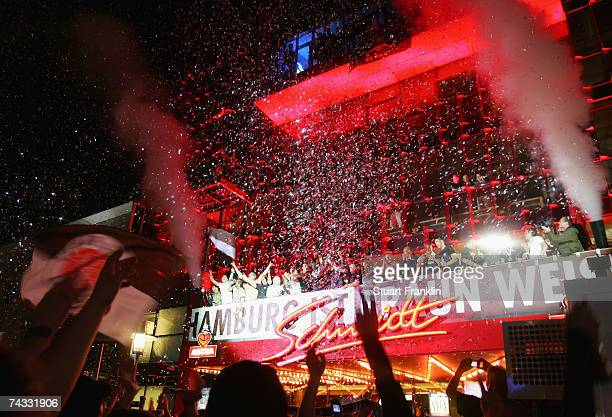 Players of FC St Pauli celebrate the promotion to the second league with fans on the famous Hamburg Reeperbahn after the Third League Northern...
