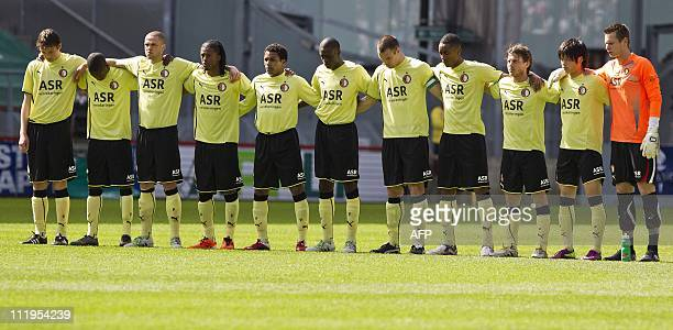 Players of Feyenoord Rotterdam observe a moment of silence in respect for the victims of the Alphen aan den Rijn shooting prior to their football...