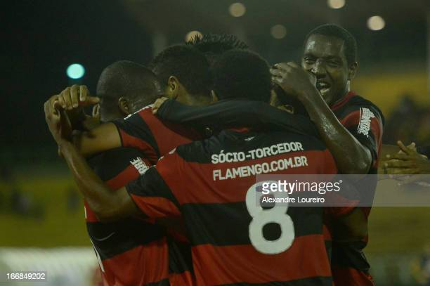Players of Flamengo celebrate a goal during the match between Flamengo and Remo as part of Brazil Cup 2013 at Raulino de Oliveira Stadium on April 17...
