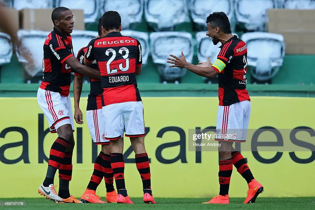 Players of Flamengo celebrate a goal during the match between Coritiba and Flamengo for the Brazilian Series A 2014 at Couto Pereira stadium on August 17, 2014 in Curitiba, Brazil.