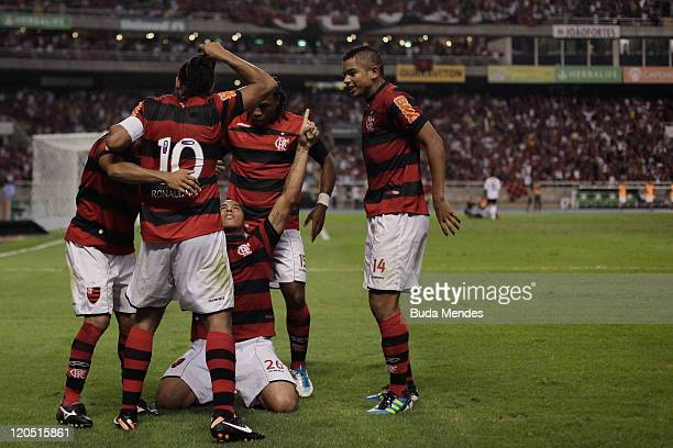 Players of Flamengo celebrate a scored goal againist Coritiba during a match as part of Serie A 2011 at Engenhao stadium on August 06 2011 in Rio de...