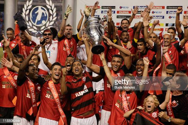 Players of Flamengo celebrate after winning the 2011 Rio State Championship at Engenhao stadium on May 1 2011 in Rio de Janeiro Brazil Flamengo won...