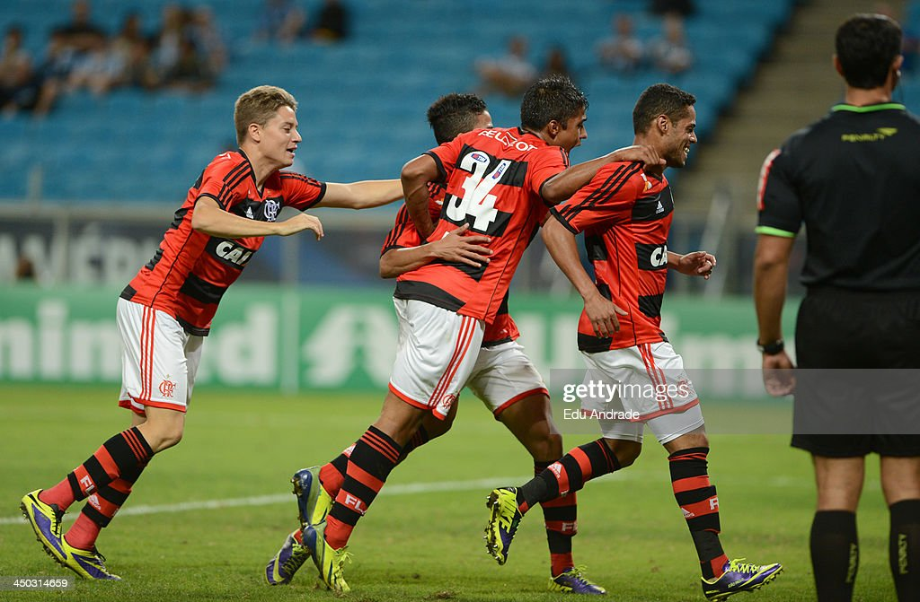 Players of Flamengo celebrates a scored goal during the match between Gremio and Flamengo for the Brazilian Series A 2013 at Arena Gremio Stadium on November 17, 2013, in Porto Alegre, Brazil.