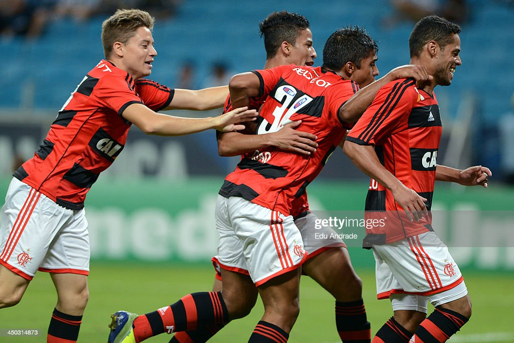 Players of Flamengo celebrates a scored goal of Joao Paulo (R) during the match between Gremio and Flamengo for the Brazilian Series A 2013 at Arena Gremio Stadium on November 17, 2013, in Porto Alegre, Brazil.