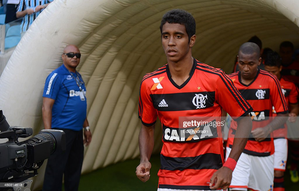 Players of Flamengo walk onto the field the match between Gremio and Flamengo for the Brazilian Series A 2013 at Arena Gremio Stadium on November 17, 2013, in Porto Alegre, Brazil.