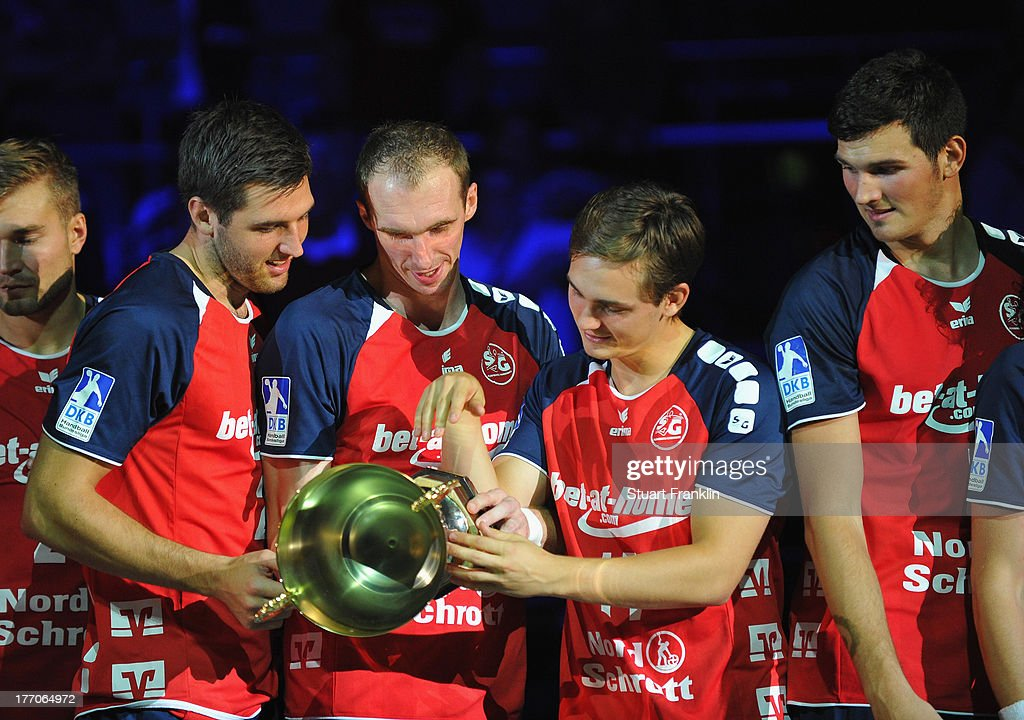 Players of Flensburg with the trophy after the DKB supercup match between THW Kiel and Flensburg Handewitt at the OVB arena on August 20, 2013 in Bremen, Germany.