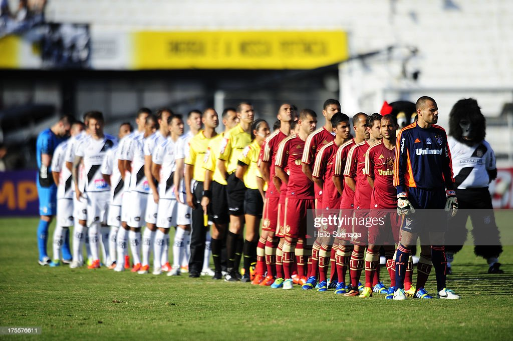 Players of Fluminense and Ponte Preta line up prior to a match between Fluminense and Ponte Preta as part of the Brazilian Championship Serie A 2013 at Moises Lucarelli Stadium on August 04, 2013 in Campinas, Brazil.