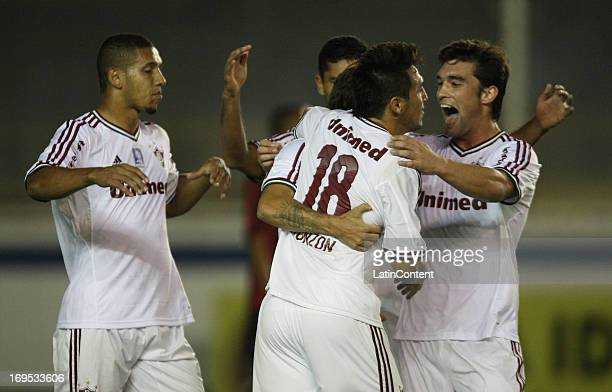Players of Fluminense celebrate a goal against AtleticoPR during a match between Fluminense and AtléticoPR as part of the Brazilian Championship 2013...