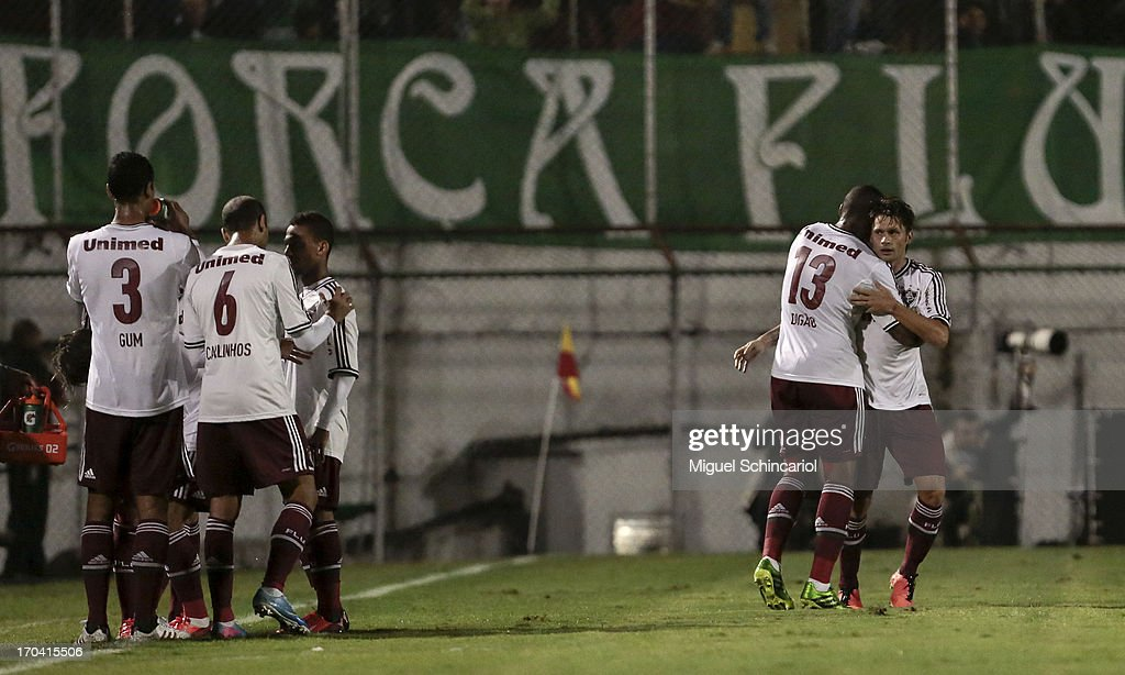 Players of Fluminense celebrate a goal during a match between Portuguesa and Fluminense as part of the Brazilian Serie A 2013 at Caninde stadium on June 12, 2013 in Sao Paulo, Brazil