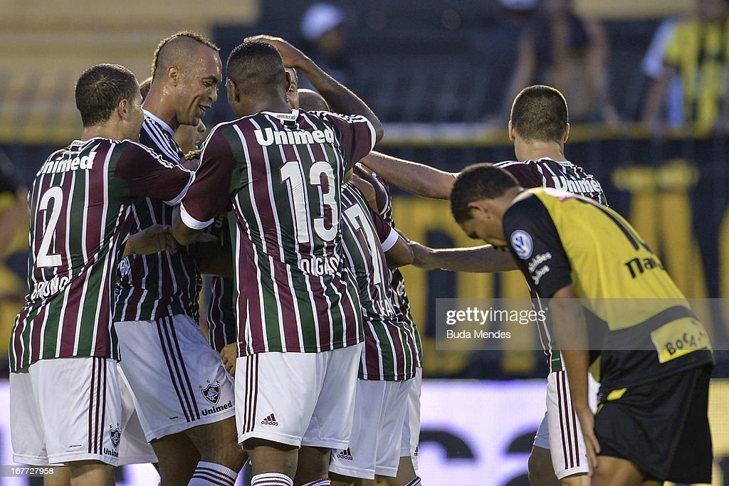 Players of Fluminense celebrate a scored goal during the match between Fluminense and Volta Redonda as part of Rio State Championship 2013 at Raulino de Oliveira Stadium on April 28, 2013 in Volta Redonda, Brazil.