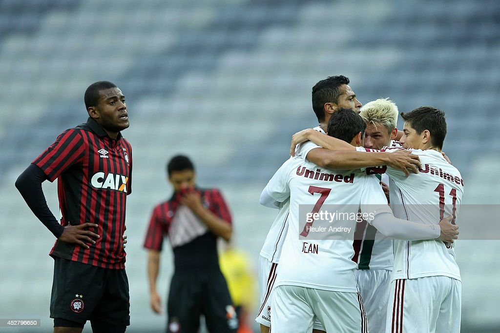 Players of Fluminense celebrate goal during the match between Atletico-PR and Fluminense for the Brazilian Series A 2014 at Arena da Baixada on July 27, 2014 in Curitiba, Brazil.