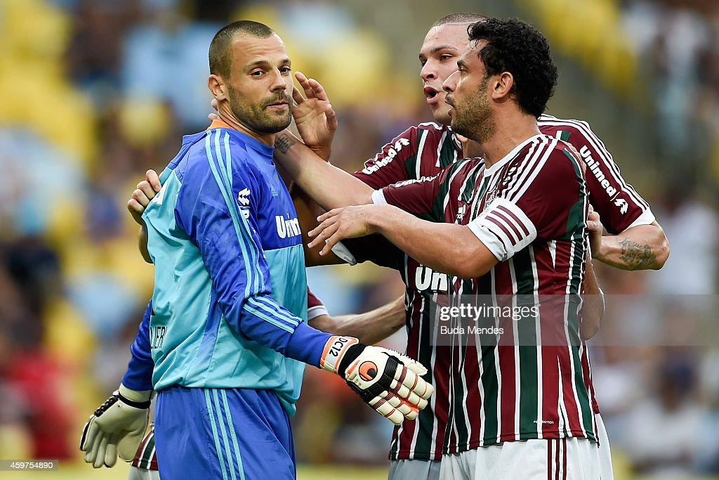Players of Fluminense celebrates with a goalkeeper <a gi-track='captionPersonalityLinkClicked' href=/galleries/search?phrase=Diego+Cavalieri&family=editorial&specificpeople=5441023 ng-click='$event.stopPropagation()'>Diego Cavalieri</a> after he defend a penalty during a match between Fluminense and Corinthians as part of Brasileirao Series A 2014 at Maracana Stadium on November 30, 2014 in Rio de Janeiro, Brazil.