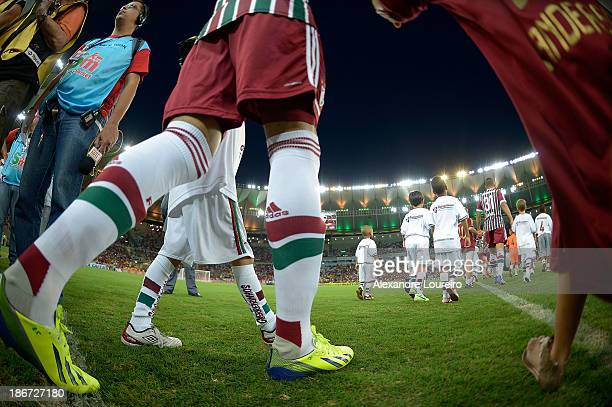 Players of Fluminense enter the field before a match between Flamengo and Fluminense for the Brazilian Series A 2013 at Maracana on November 3 2013...