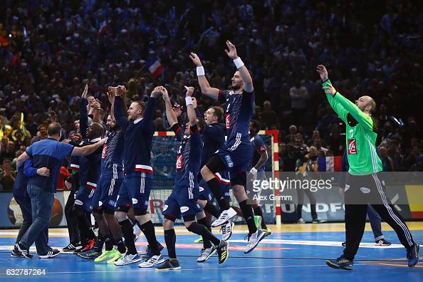 Players of France celebrate after the 25th IHF Men's World Championship 2017 Semi Final match between France and Slovenia at Accorhotels Arena on...