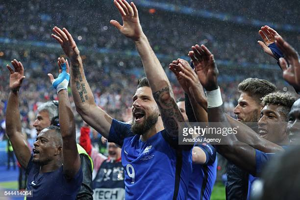 Players of France celebrate victory over Iceland after the UEFA Euro 2016 quarter final match between France and Iceland at Stade de France in Saint...