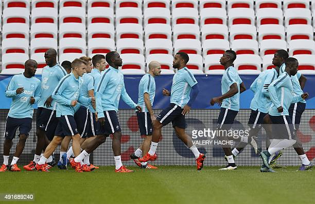 Players of France's national football team attend a training session on the eve of the friendly football match France vs Armenia on October 7 2015 at...
