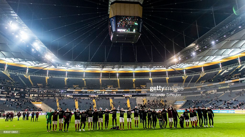 Players of Frankfurt celebrate the victory during the Bundesliga match between Eintracht Frankfurt and 1. FSV Mainz 05 at Commerzbank-Arena on December 20, 2016 in Frankfurt am Main, Germany.