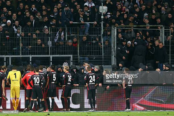 Players of Frankfurt talk to the fans after the Bundesliga match between Eintracht Frankfurt and SV Darmstadt 98 at CommerzbankArena on December 6...