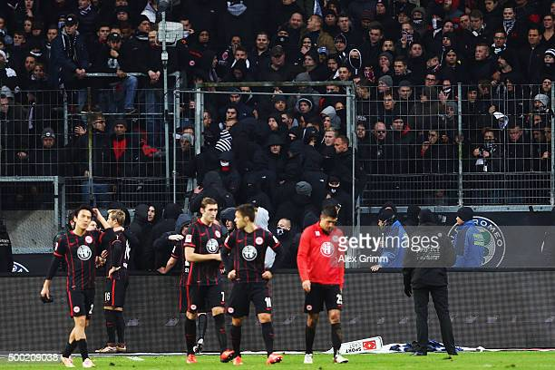 Players of Frankfurt walk off as fans try to enter the pitch after the Bundesliga match between Eintracht Frankfurt and SV Darmstadt 98 at...