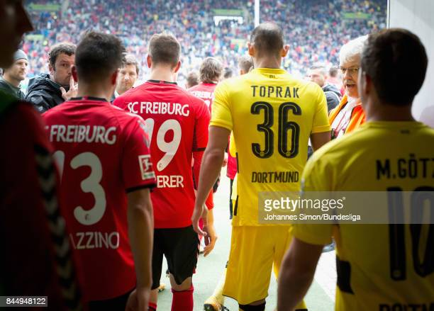 Players of Freiburg and Dortmund leave the player's tunnel for the second half of the Bundesliga match between SportClub Freiburg and Borussia...