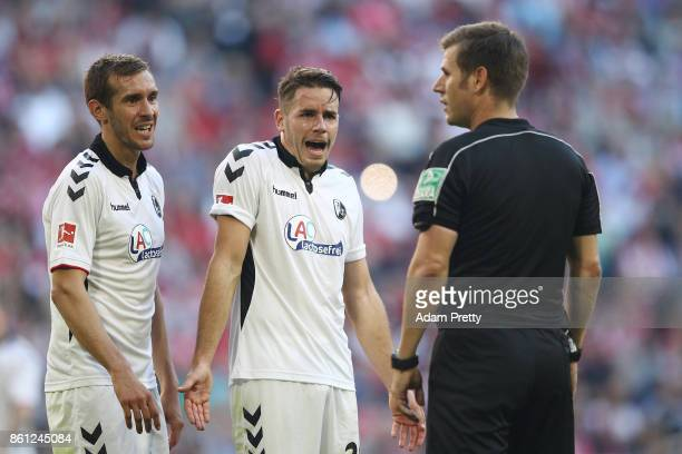 Players of Freiburg argue with referee Frank Willenborg after he awarded a penalty to Muenchen during the Bundesliga match between FC Bayern Muenchen...